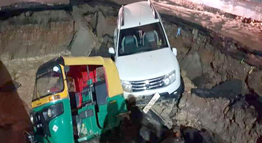 Deep, Crater, Under, Subway, Station, Two, Vehicles, Collapsed