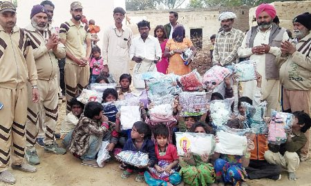 celebrating Avatar month distributing clothes to the needy children