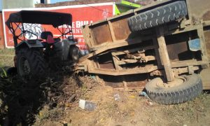 Tire bursts inverted tractor, driver dies
