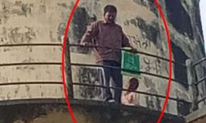 a man climbed into a water tank with his daughter for land acquisition