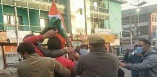 BJP Worker Hoisting Flag